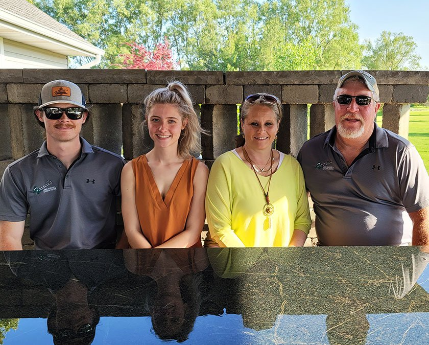 Owner's family sitting at a table with quartz countertop.