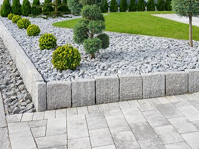 Building entrance with pavers and landscaping
