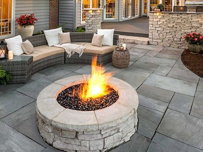 Small patio with sitting area and stone fire pit