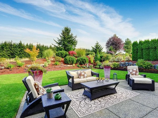 Outdoor living space with concrete patio and furniture